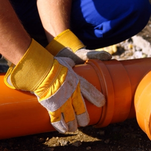 sewer line being placed on ground on dirt